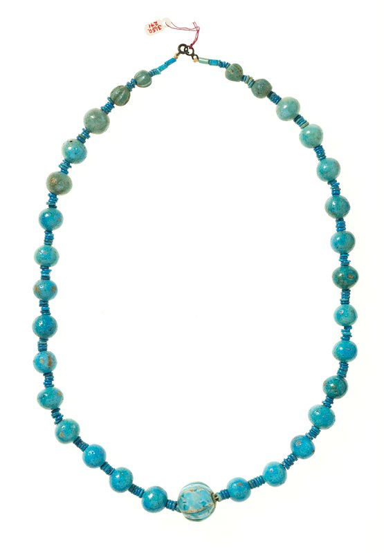 Necklace, faience; unnumbered; necklace of 31 beads with 31 beads with greenish-blue glaze, large melon-shaped bead at center and each bead separated by small disk beads.
