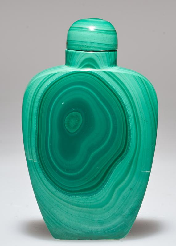 Snuff bottle, green malachite showing wavy pattern of light and dark stripes. Malachite top; stand.