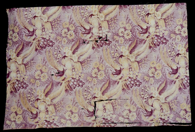 Toile, length of, printed in plum and yellow with a large scale repeat design of birds, flowers, and baskedt of fruit.