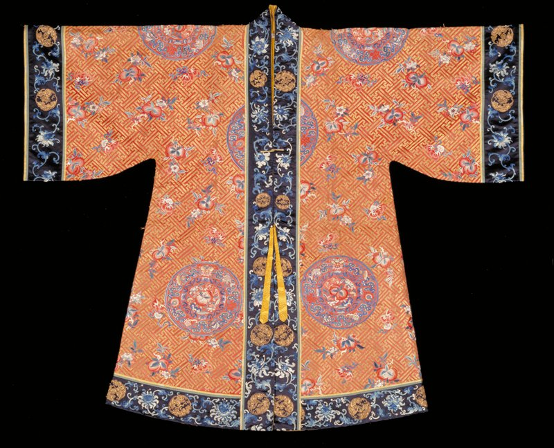 Taoist Priest's Robe embroidered with the Pa Pao (Eight Precious Things) in eight large medallions. Faded rust satin ground with all-over meander in gold thread, and double peach and bat motifs embroidered in satin stitch in peach, blue, and shades of coral. Three medallions on back; three on front; one on each sleeve.