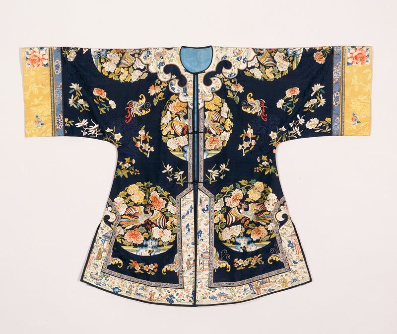 Outer coat of deep blue silk of dragon medallion pattern embroidered with large phoenix and peony medallions, floral sprays and butterflies in shades of bule, yellow, green, peach, pink and rust. Shaped collar-band, bottom and side border of white satin embroidered in a landscape design with figures of men and women. Wide sleeves with cuffs of brocaded yellow silk embroidered with large peony and lotus blossoms and butterflies in shades of red, pink and blue. Secondary border of grey satin embroidered with flowers and long-life characters in shades of blue. This coat opens all the way up front, and is probably a woman's coat. Lining of thin blue patterned silk. Cheifly satin and knot stitch.