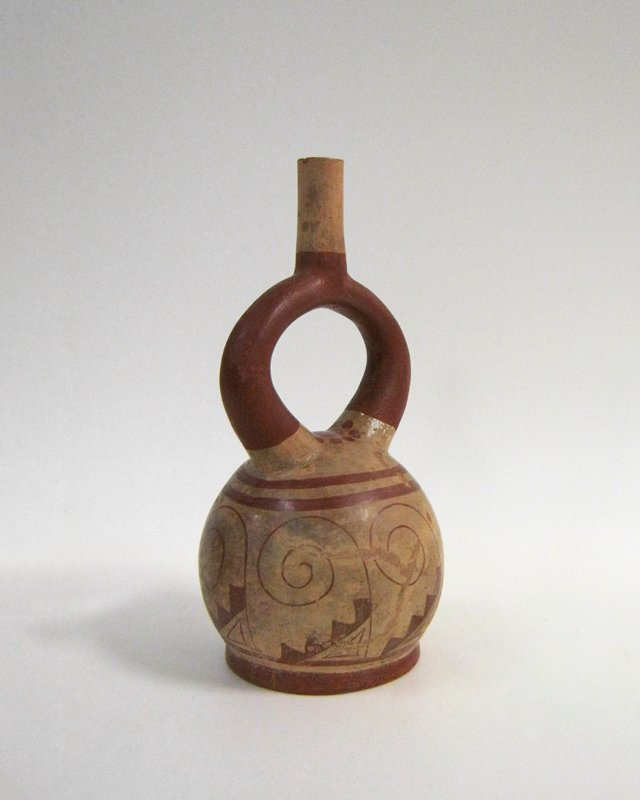 Stirrup jar with an abstract design of spirals and stepped motives in rust red on a cream slip ground.