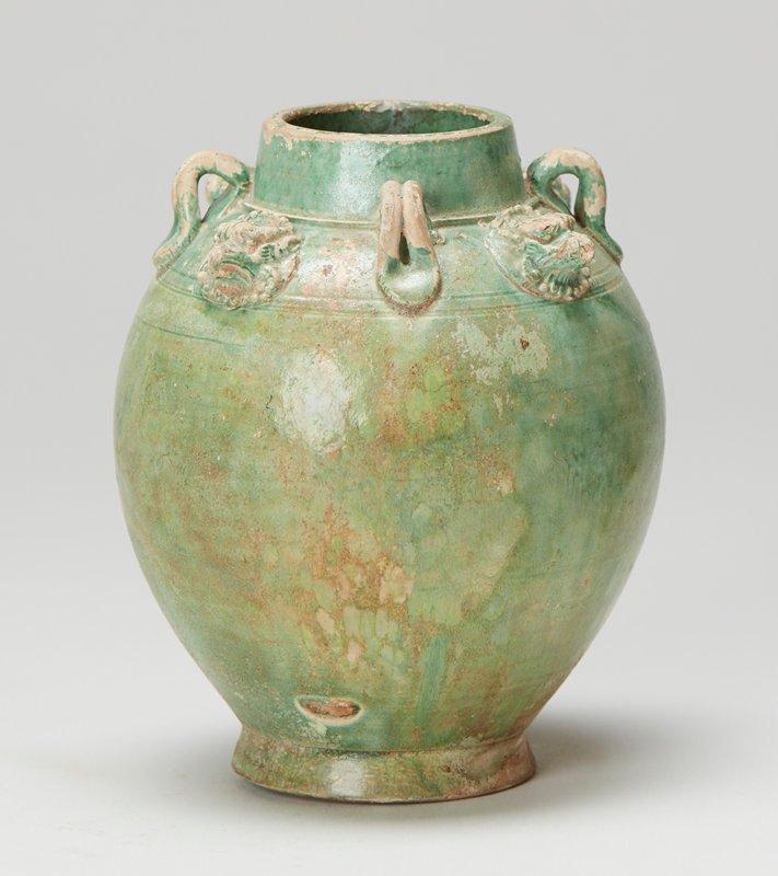 Vase, glazed green- four small handles. White earthenware