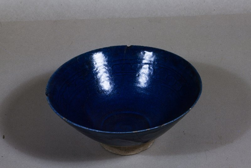 Bowl, lapis blue glaze over a band of incised roundels.