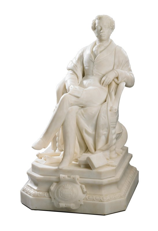 Anatole Demidoff, Prince of San Donato (1812-1870) was a distinguished scientist and explorer, as well as art collector. He is shown in this portrait with the attributes of his collecting--a classically inspired ewer and basin--and tools indicative of his scientific explorations--a globe, maps, a telescope and a compass. The books by his feet and the pamphlet in his hand bear the titles of his scholarly publications on the natural history, geology and anthropology of Crimea and southern Russia. The prince's crest, a three-dimensional rendition, is affixed to the center of the base.