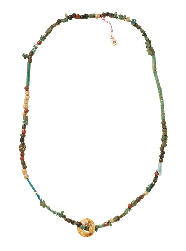 Various colored faience and stone beads of an amuletic nature.