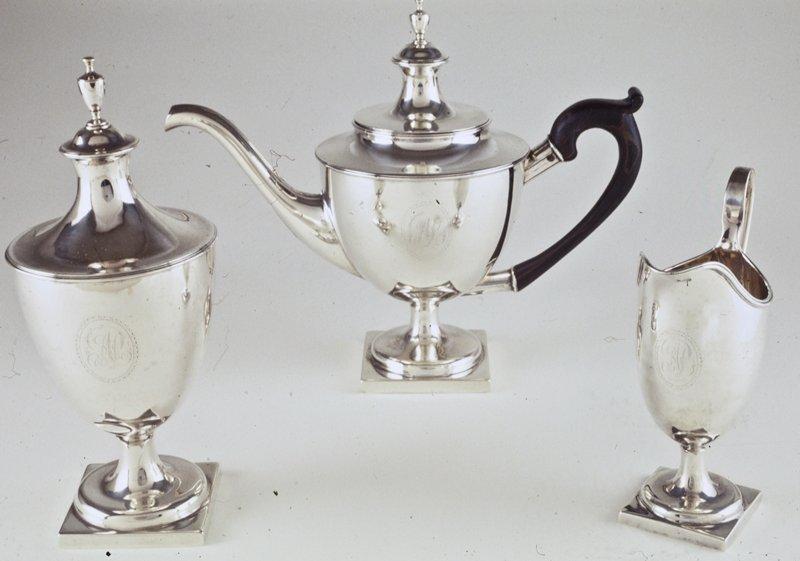 part of a tea set; vase-shaped teapot with wood handle, removable lid