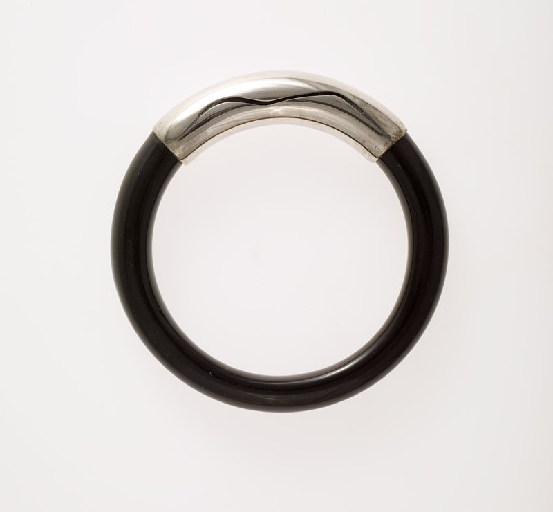 circular; black Belgian marble and silver