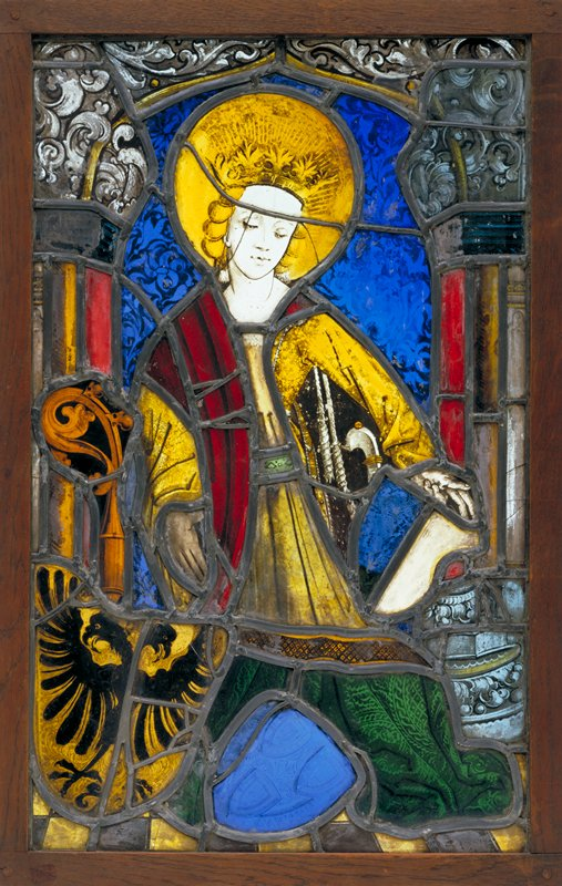 standing female saint with two heraldic shields at her feet