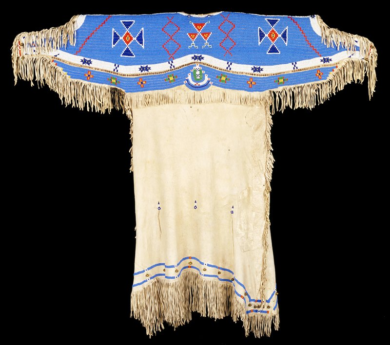 woman's dress; leather with beadwork, copper discs and bells; yoke completely beaded on blue ground