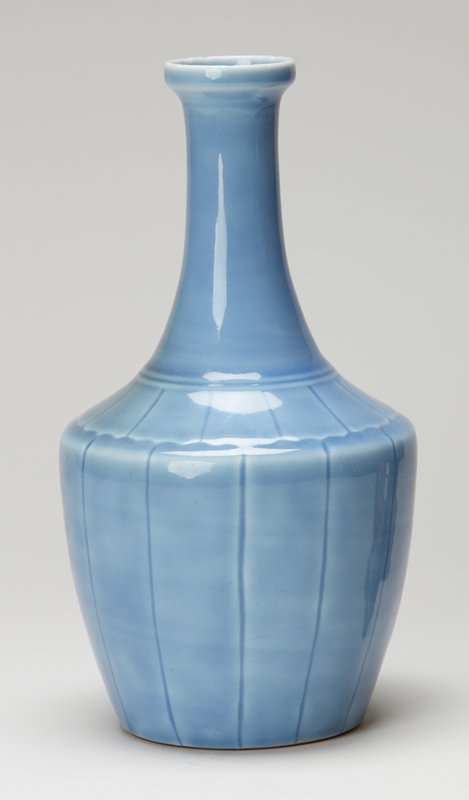 vase bottle-shaped, shouldered body and tall neck, molded underglazed flower petal design and incised lines running vertically down body; blue glazed porcelain