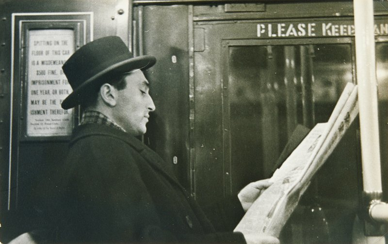 profile of man reading a newspaper