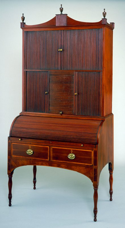 two-part Federal-style Secretary desk with roll-tambour base, the top section with 5 tambour slide compartments; mahagony with inlay of variety of woods; a- top; b-bottom; c- left inner drawer; d- right inner drawer; e- left bottom drawer; f- right bottom drawer