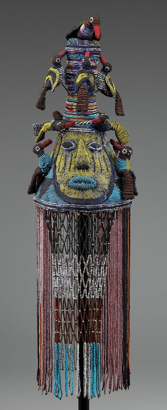 ritual beadwork with face and sixteen birds mounted on the crown; long fringe hangs from crown
