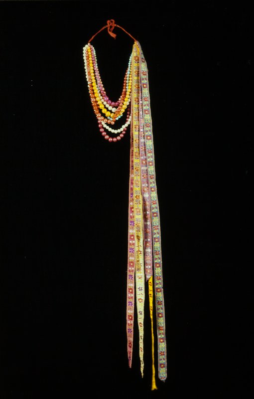 8-strand multicolored bead necklace, with embroidered ribbons tied at one side