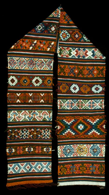Yattha, single panel wool brocade on wool background; horizontal bands of geometric pattern in orange, blue, green, red wool; twill weave; discontinuous supplementary weft; one end fringed.