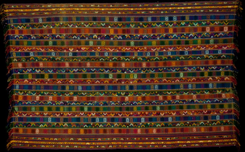 Kira, Oshem; silk/cotton brocadee on blue or black background; L.93-1/2 in., W.55-1/4 in. 3 panels, predominantly red, blue and green stripes with discontinuous supplementary weft overall pattern.