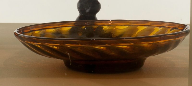 Sweetmeat dish, amber 24 ribs, swirled and infolded rim; attributed to Zanesville; bottle and dishes from Ohio Manufacturers, 159 items in all, from the Walter Douglas Collection in Centerville, Ohio