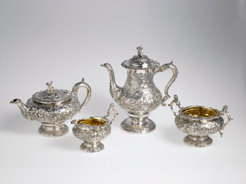 Coffee and Tea Set, 1823, four pieces. Marks JA, walking lion, leopard's head, lower case (n), monarch head in profile. Shield with double headed lion and motto, quoteI bide my time.