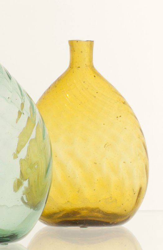 Chestnut bottle, golden yellow color, 20 ribs, left-hand swirl, faint broken swirl; attributed to Kent (glasshouse); bottles and dishes from Ohio Manufacturers, 159 items in all, from the Walter Douglas Collection in Centerville, Ohio
