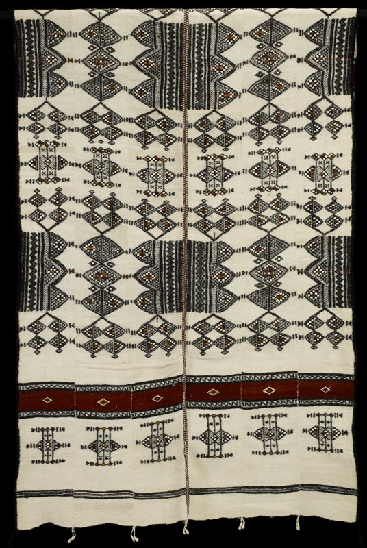 "man's coverlet, wool, African (Mali-Fulani), stored in box; 'Simmons African'; (stored with 86.100.39); called ""Ladaka,"" S85-89; designs: Bicirgal and Take Boje dow serra bodejo"