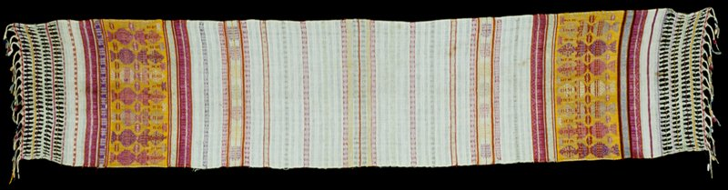 "Cloth, 1920-1940, cotton and silk, openwork, fringed border. Woven in Totonicopan for use in Quetzaltenango. Called a ""mouth wiping cloth"" for use by Cofradia. Called a Subalchi."