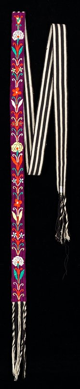 Black and white warp-faced striped ground; center one-third is covered by magenta wrapping which is couched to ground cloth; floral embroidery accomplished in satin, chain and plaited stitches.