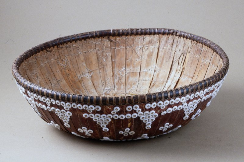 Temple Basket, fiber, stitching, beadwork, fabric covers base, commercial buttons are stitched to fibers and fabric