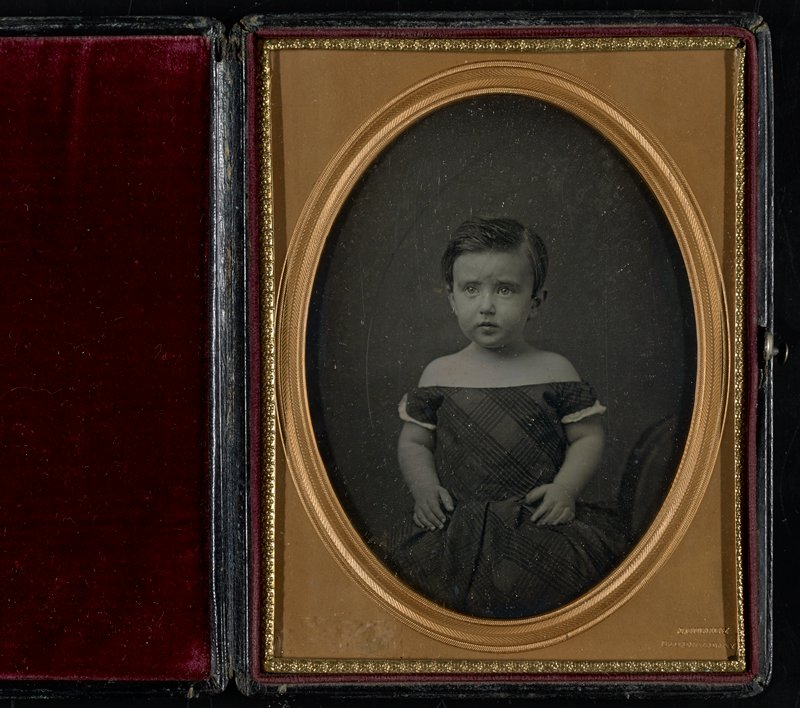 1/2 plate daguerreotype in leather case and burgundy velvet cushion