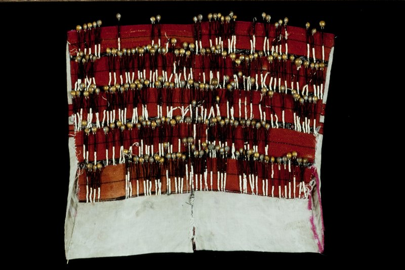 woman's blouse, cotton, wool, glass beads, and metal bells; supplementary weft patterning and applied bells