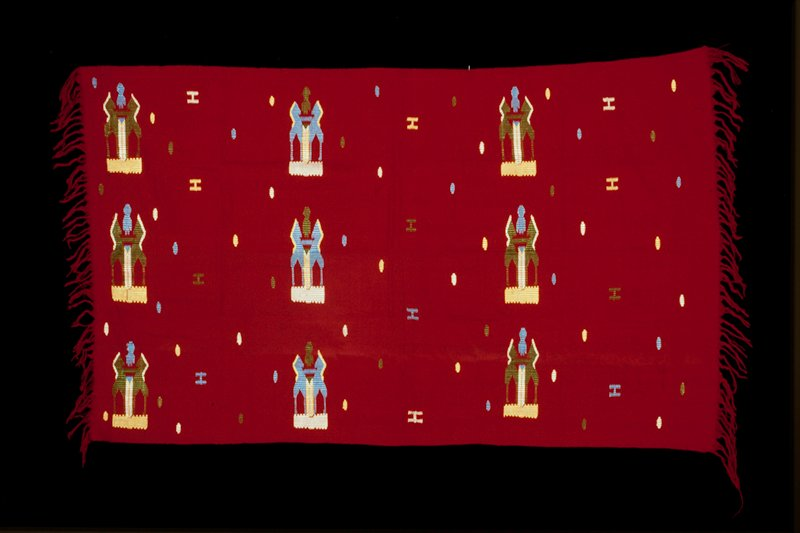 """red ground """"coat of arms"""" pattern in discontinuous supplementary weft patterning"""