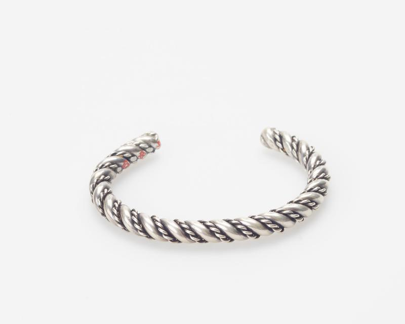 Hopi; pair of identical gaurds; twisted silver wire overlaid with fine double twisted silver wire; cat.171(both), J#219