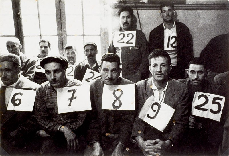candidates wearing numbers so that illiterate voters may identify them during the first election in Algeria after independence