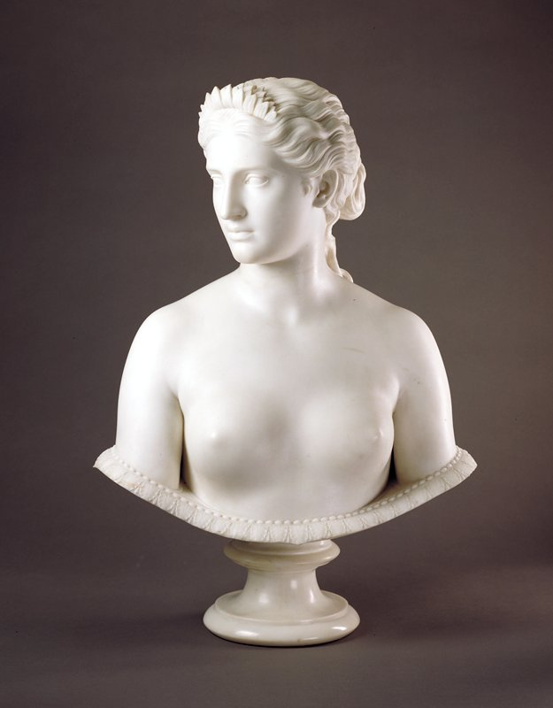 full bust, undraped, head turned half-left with gaze in same direction, slightly downward. The figure terminates just below the breasts by means of a shallow, saucer-like border with reeded edge and is attached to a circular socle. The hair is dressed with a small sunflower, symbolizing the allegory.