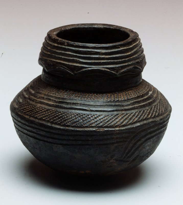black earthenware with series of textured rings in different patterns