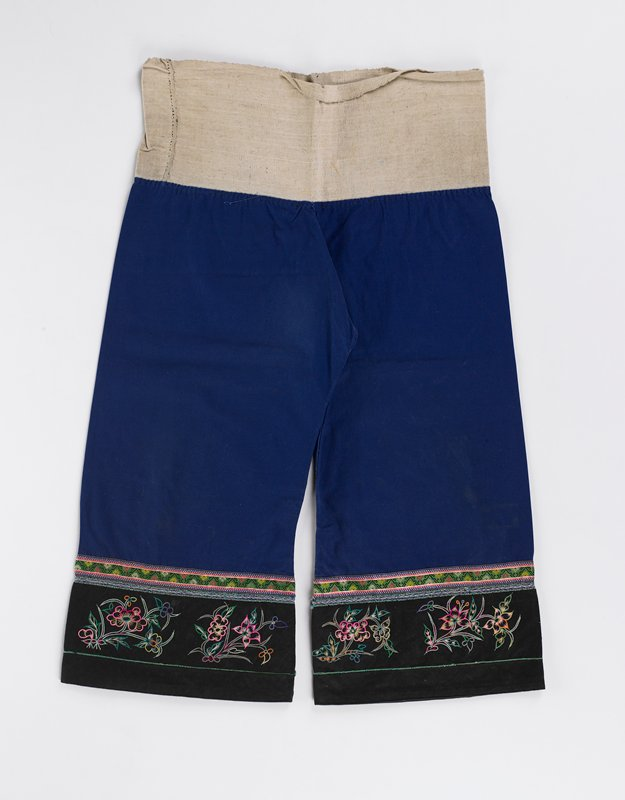 blue cotton, natural cotton at waist, woven, embroidered, black plain weave bands at bottom of each pant leg
