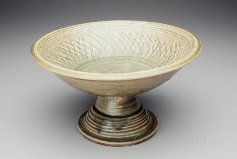 green glaze over an inscribed cross-hatch design inside bowl; banding around inside rim and in bottom; plain exterior