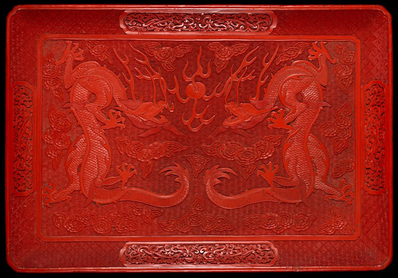 rectangular with central carved dragon; floral reserves on latticed border