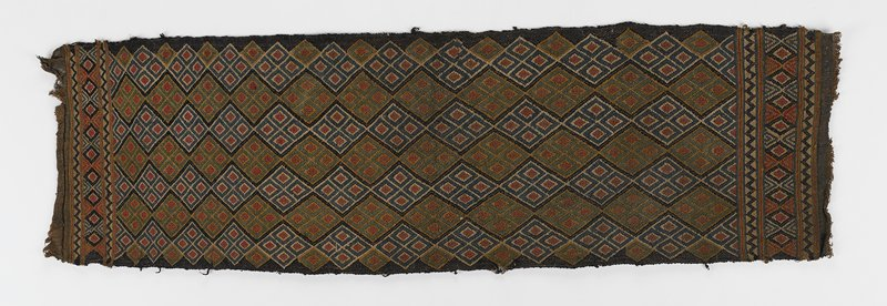 single panel, long edges finished, short ends unfinished; three bands at short sides; seven diamond design stripes through central field; colors of blue, green, yellow, red, brown, white