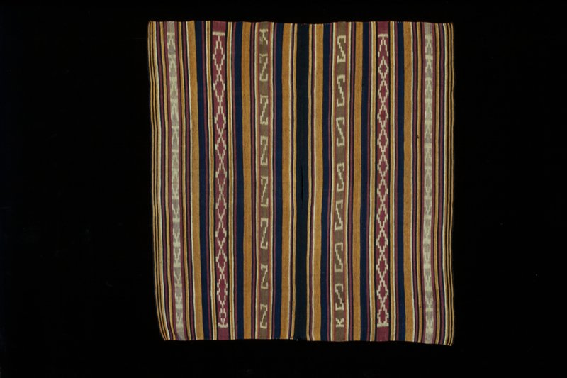 two panel; varying stripes of blue, red, yellow and gold; each panel had three stripes with geometric designs of 'Z's, diamonds and T/U shape; opening at center of seam