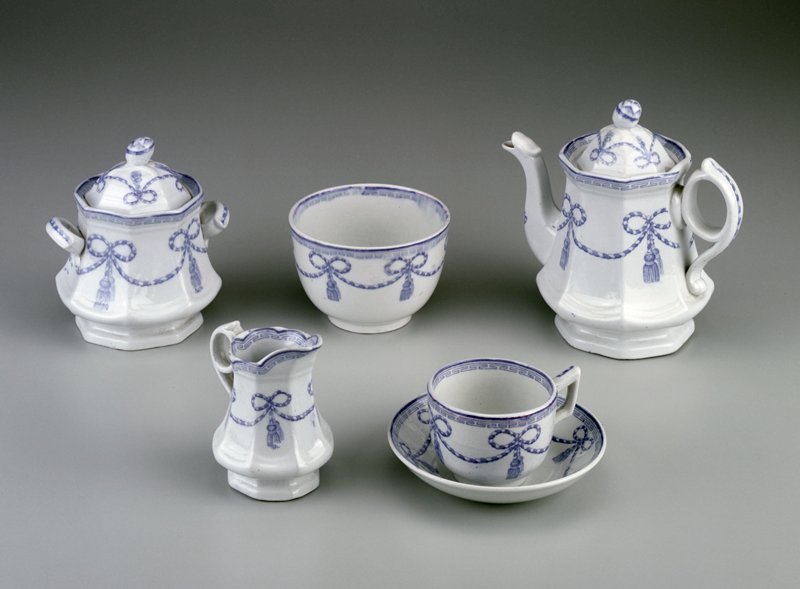 teapot, creamer and sugar bowl have octagonal shapes; light blue decoration is named, 'Cord and Tassel'