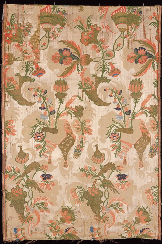Bizarre brocade work in ivory satin with green and red floral decoration; silk, gold, and silver threads