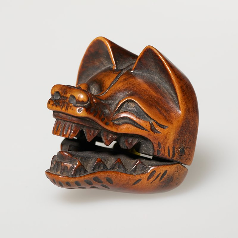 fox head with movable jaw, lips curled back showing teeth; orange thread on back