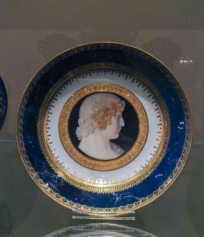 Plate, ceramic-porcelain, dark blue with gold border; large medallion head in the center of Antinous, signed by 'Mlle de Gaule', French, XIXc cat. card dims H 1-1/4 x diam 9-3/8'