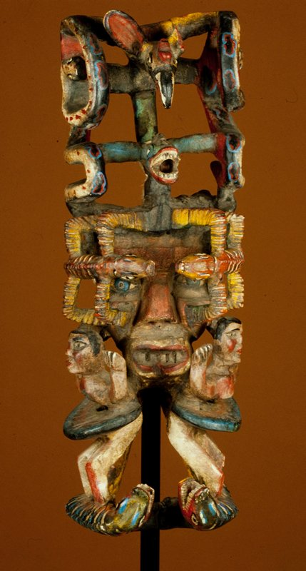 attributed to school of Jose Rodriguez. Mask, wood, painted. Serpentine design with central human face surrounded by reptiles and serpents. Cuadrilla Santa Anita, a settlement in eastern Guerrero state.