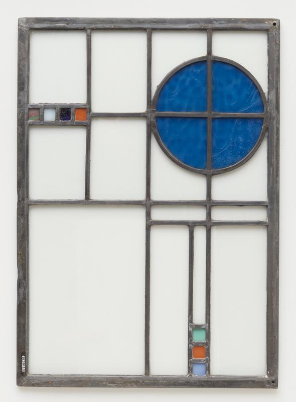 clear glass panels with blue circle on one side; 4 small squares opposite (green and pink swirled, white, dark blue and orange) and 3 squares at one short side (blue, orange, green)