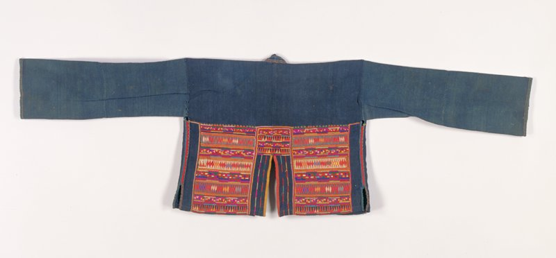 indigo dyed cotton jacket without closures; slits at sides and center back; multicolored geometric embroidery and applique on back at lower panels