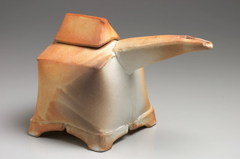 square body with domed top and sides; long, tapering spout with rectangular opening; square mouth; roof-shaped cover; mottled tan, white and grey glaze