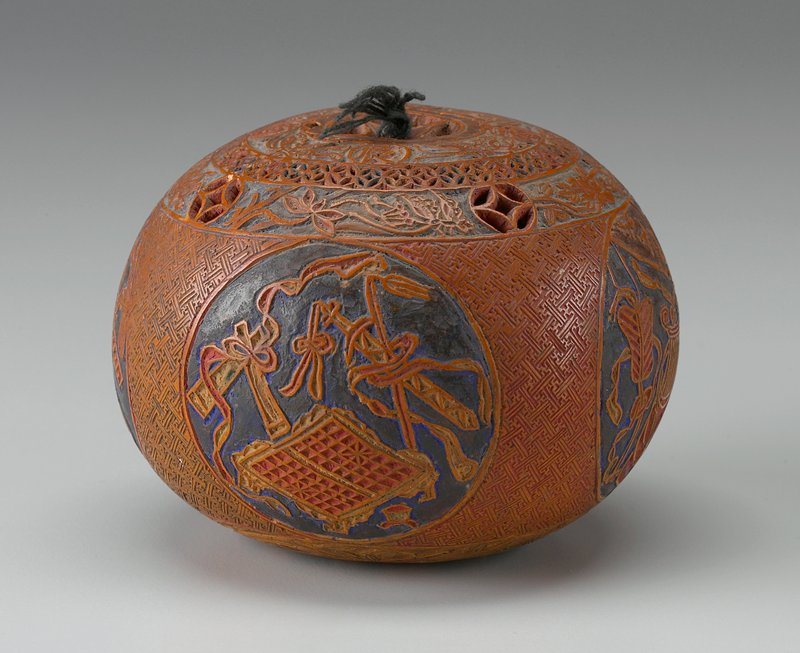 round gourd carved with 4 cartouches containing objects on sides and bands of organic and geometric designs at top and bottom; yellow, red, blue and green pigment; cover attached to gourd with cord