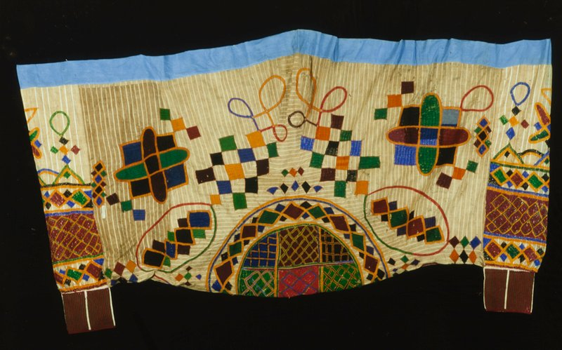 man's pants, cotton, silk embroidery, African; stored in box; (Simmons); stored w/86.100.6ab,27 cotton, stripwoven, embroidered with multicolored silk threads, blue broadcloth waistband; striped beige and white cotton with embroidery in orange, green, black, blue, red and purple
